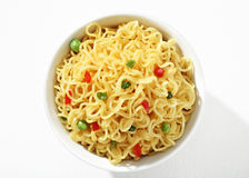 Vermicelli with green peas and chopped bell pepper in white bowl Royalty Free Stock Photography
