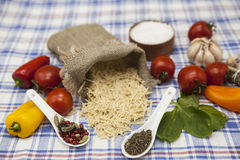 Vermicelli Italian pasta set for the creation : cherry tomatoes, olive oil, balsamic sauce, garlic, spices, sea salt, salad on a r Royalty Free Stock Photo