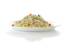 Vermicelli and the vegetables. Plate with the vermicelli and the vegetables against the white background Stock Images