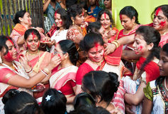 Vermilion ceremony. CALCUTTA - OCTOBER 6: Married Bengali Hindu women smear and play with vermilion during Sindur Khela traditional ceremony on the final day of Stock Photo