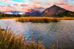 Vermilion Lakes Sunset near Banff. Golden early fall sunset over the Canadian Rockies and Vermilion Lakes on the outskirts of Banff, Canada Royalty Free Stock Image