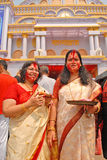 Vermilion Play. Beautiful Hindu women smear and play with vermilion during Sindur Khela traditional ceremony on the final day of Durga Puja festival Stock Photography