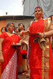 Vermilion Play. Beautiful Hindu women smear and play with vermilion during Sindur Khela traditional ceremony on the final day of Durga Puja festival Stock Photo