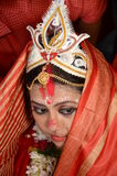 Vermilion. Portrait of a bride after vermilion applieda symbol of marriage worn by Hindu women thereafter on the bride`s hair-parting. The bride then covers her Stock Images