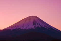 Vermilion sky and the summit of Mount Fuji, a world heritage in Japan Stock Photos