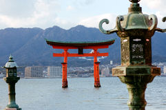 Vermilion tori and lanterns, Miyajima Island Royalty Free Stock Photography