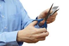 Verminder uw concept van de creditcardschuld met schaar en kredietca stock afbeeldingen