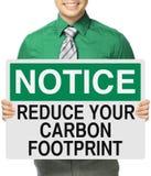 Verminder uw koolstofvoetafdruk Stock Afbeeldingen