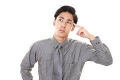 Vermoeide Aziatische zakenman stock fotografie