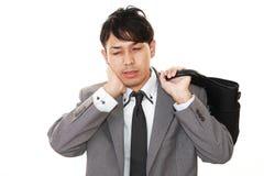 Vermoeide Aziatische zakenman stock foto's