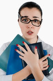 Vermoeide bedrijfsvrouw met omslagen en glazen voor visie in haar Royalty-vrije Stock Foto