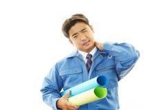 Vermoeide en beklemtoonde Aziatische arbeider Royalty-vrije Stock Foto's