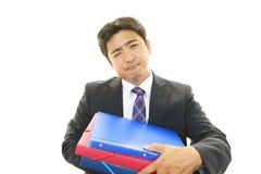 Vermoeide en beklemtoonde Aziatische zakenman royalty-vrije stock afbeeldingen