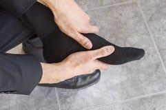 Vermoeide en pijnlijke voeten Stock Foto