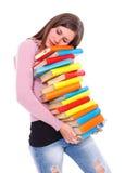 Vermoeide meisjes dragende boeken stock foto