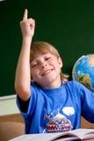 Vermoeide schooljongen met zijn omhoog hand Royalty-vrije Stock Afbeelding
