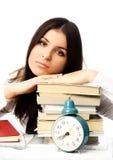 Vermoeide student met boeken Stock Foto's