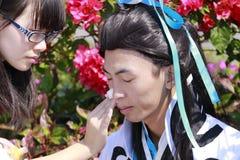 Vermomd als oude Chinese beeldverhaalkarakters Royalty-vrije Stock Afbeeldingen