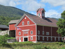 A Vermont barn. A beautiful large barn with the Green Mountains of Vermont in the background Stock Photography