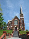 Vermont Catholic Church. A Vermont Catholic Church sits high on a hill and has an amazing amount of stairs to climb to get there. It stands out in all it's Royalty Free Stock Photography