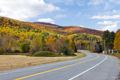Vermont Country Road in Fall. Country road through the Fall forest in Vermont Royalty Free Stock Photography
