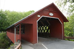 Vermont Covered Bridge. A beautiful red covered bridge built in 1879 and a sidewalk added in 1917 spans the Whetstone Brook. It is 80'long and 19'wide Royalty Free Stock Photo