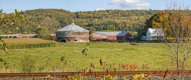 Vermont Dairy Farm with Round Cow Barn, House and Fields Stock Photos