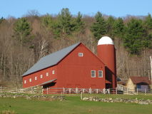 Vermont Red Barn. A beautiful large red barn sits high on a Vermont hillside Stock Image