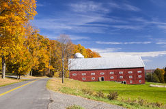 Vermont Red Dairy Barn and Colorful Autumn Foliage Royalty Free Stock Photography