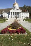 Placard outside Vermont State House. Vermont State House exterior against blue skies on sunny day Stock Image