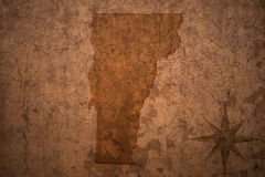 Vermont state map on a old vintage paper background. Vermont state map on a old vintage crack paper background Royalty Free Stock Photo