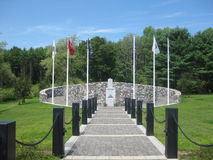Vermont Vietnam Veterans Memorial. Flanked be flags, the memorial and it's amphitheater are open year round. A geothermal snowmelt system heats the walkways and Stock Images