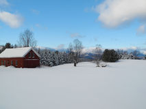 Vermont In Winter. A Vermont barn covered in snow during the heart of winter Stock Images