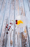 Vermouth cocktail with orange and cherry fruit in the glass.  Royalty Free Stock Photo