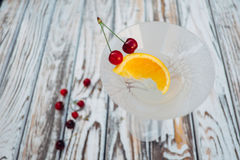Vermouth cocktail with orange and cherry fruit in the glass.  Royalty Free Stock Image