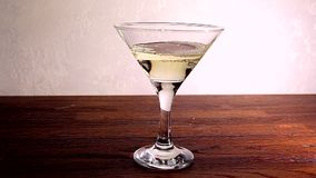 Vermouth and olive in a glass stock video footage