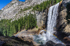 Vernal Falls. Rainbow in front of Vernal Falls, Yosemite National Park, USA, in early spring. b Royalty Free Stock Photo