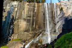 Vernal Falls yosemite national park with a woman for scale. stock photo