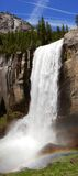 Vernal Falls - Yosemite NP. Vernal Falls thunders with spring snow-melt, soaking hikers who brave the famous Mist Trail, which runs alongside, Yosemite National Stock Photo