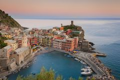 Vernazza, Cinque Terre, Italy. The colorful village of Vernazza after sunset. Cinque Terre, Italy. Unesco World Heritage Stock Photos