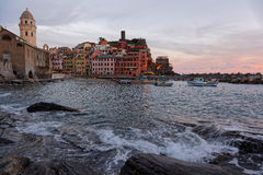 Vernazza at dusk with waves breaking on the rocks Royalty Free Stock Photo