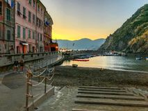 Vernazza harbor in early evening light: Cinque Terre, Italy. Oct 2017: Harbor of Vernazza, Cinque Terre, Italy, after sunset, in golden light stock photography
