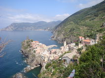Vernazza on Italian coast provides a dramatic scene. The pretty town of Vernazza is situated on steep sloping hillsides along the Mediterranean coast of Italy in stock photography