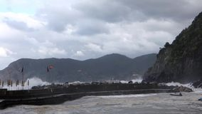 Vernazza, Italy - April 28, 2017 - Sea Storm Hits Vernazza As Waves Hit Flags