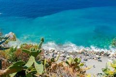 Vernazza. The rocky beach near the village. Stock Photo
