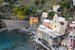 Vernazza town, located in Cinque Terre national park, with beautiful houses and old fortress ruins Royalty Free Stock Image