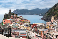 Vernazza town, located in Cinque Terre national park, with beautiful houses and old fortress ruins Royalty Free Stock Photo