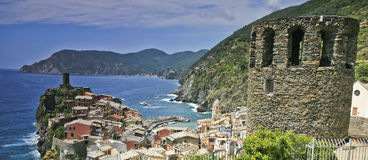 Vernazza town scenic Italy. Scenic view of coastal town of Vernazza with old tower in foreground, La Spezia, Liguria, Cinque Terre region, Italy royalty free stock photo