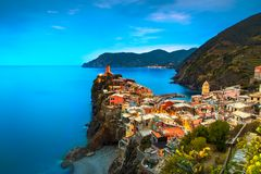 Vernazza village, aerial view on red sunset. Cinque Terre, Ligur. Vernazza village, aerial view on red sunset, Seascape in Five lands, Cinque Terre National Park Stock Photo
