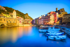 Vernazza village, church, boats and sea harbor on sunset. Cinque Royalty Free Stock Image